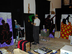 E.J. Gold is well-known as a JazzArt painter, here preparing work for the International Association for Jazz Education